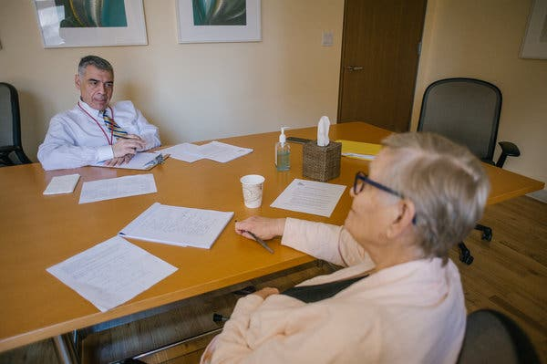 Dr.Dimitris Kiosses with Ms. Firmender. She said the treatment helps her focus on solving problems.