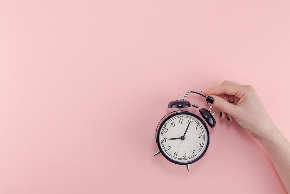 9-natural-ways-to-get-a-better-nights-sleep-alarm-clock-pink-background.jpg